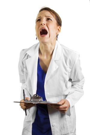 실험실 코트를 입고 좌절 의사 스톡 콘텐츠