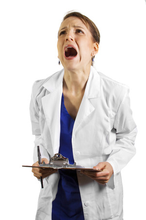 stressed: frustrated doctor wearing a lab coat