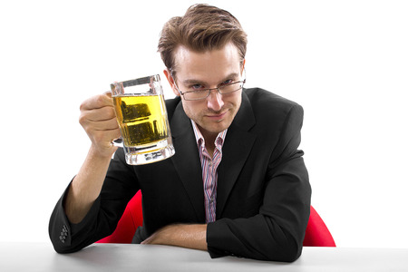 Businessman drinking beer on a white countertop Stock Photo - 25160425