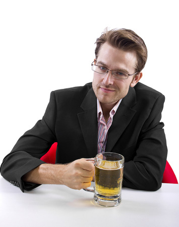 Businessman drinking beer on a white countertop photo