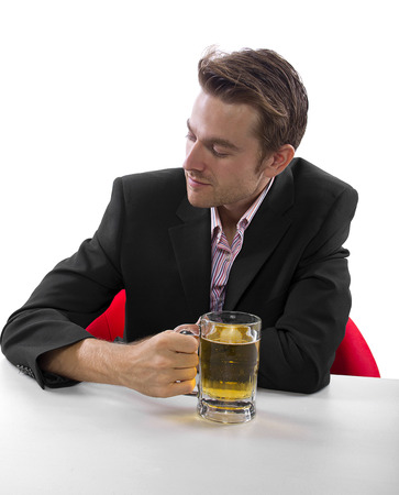 Businessman drinking beer on a white countertop Stock Photo - 25160423