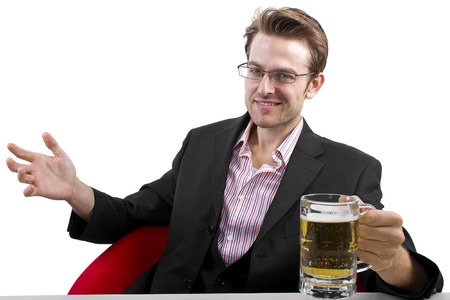 Businessman drinking beer on a white countertop Stock Photo - 25160435