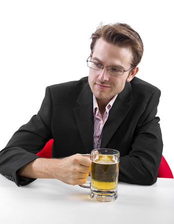 Businessman drinking beer on a white countertop Stock Photo - 25160583