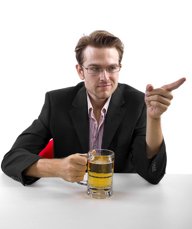 Businessman drinking beer on a white countertop Stock Photo - 25160581