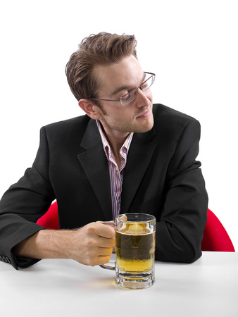 Businessman drinking beer on a white countertop Stock Photo - 25160582
