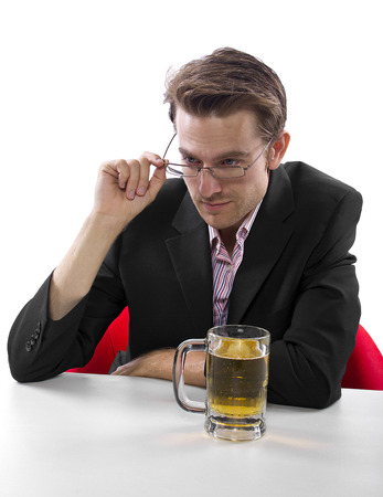 Businessman drinking beer on a white countertop Stock Photo - 25160579