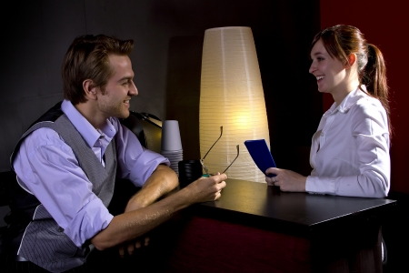 young businessman ordering coffee from female waitress photo