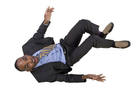 downfall: falling young black businessman from top view Stock Photo