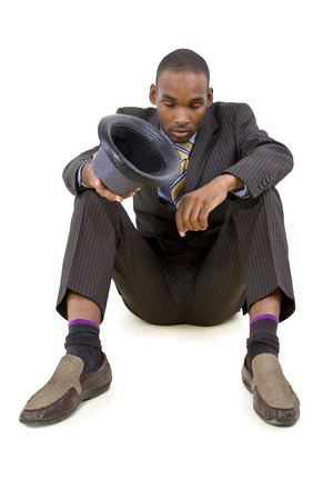 young depressed black businessman sitting in a corner photo