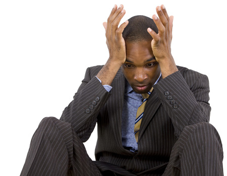 young black businessman stressed or depressed about failure Stock Photo - 25282693