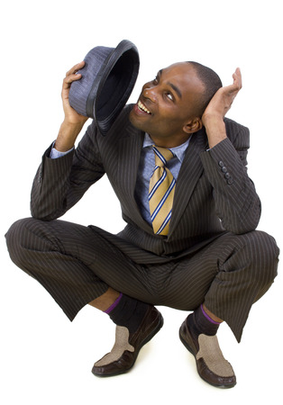 young black businessman ducking from unseen threat photo