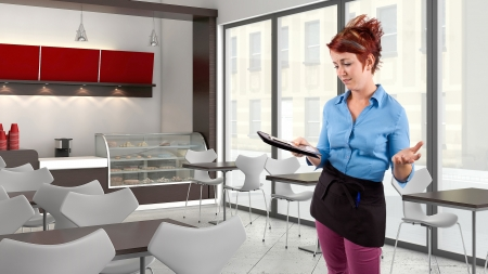 chit: young red head waitress fed up with her job  Stock Photo