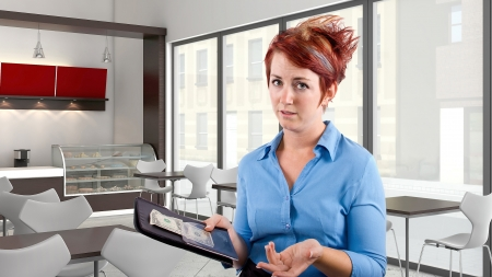 angry women: young red head waitress fed up with her job  Stock Photo