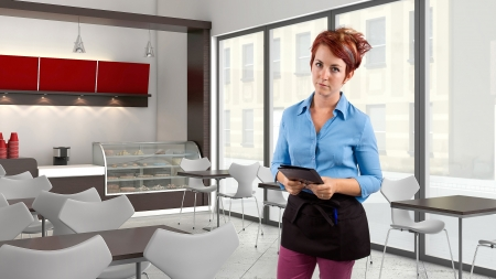 unfriendly: young red head waitress fed up with her job  Stock Photo