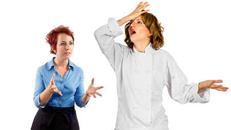 young female chef and waitress co-workers fighting photo