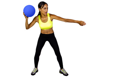 young female dodgeball player with a blue ball 写真素材