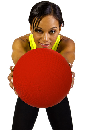 woman black background: young black female with red a dodgeball Stock Photo