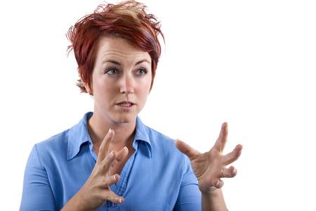 reacting: young redhead waitress reacting to stress Stock Photo