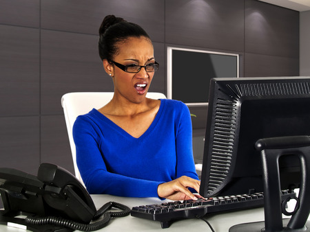 woman boss: business woman at work in the office with computer