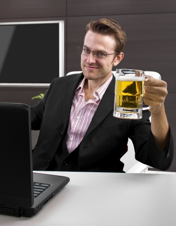 Caucasian male on a laptop computer in an office Stock Photo - 25603953
