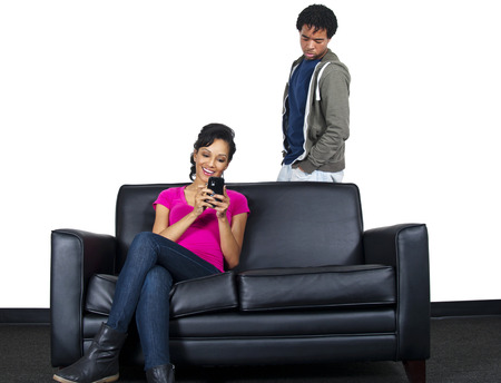 Distrusting Couple - Snooping at text messages Stock Photo