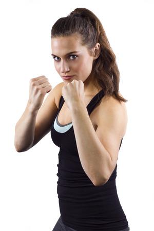 jonge vrouw in het bestrijden van houding op wit Stockfoto