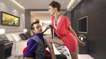 young male being seduced by a bossy female photo