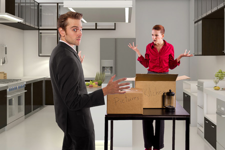 breaking up: young caucasian couple breaking up and moving out Stock Photo