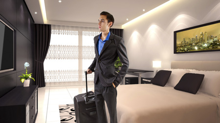 young caucasian businessman travelling with luggage or baggage