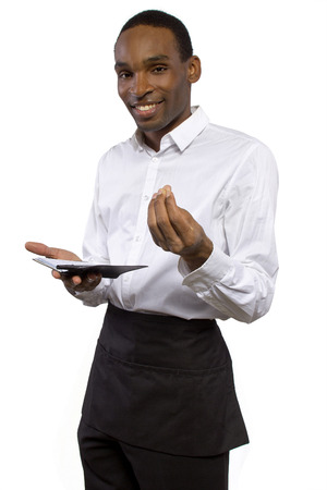 young African-American waiter wearing an apron on white background photo