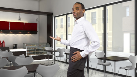 young African-American waiter working in a coffee shop