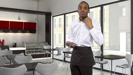 tired young African-American waiter in a coffeeshop photo