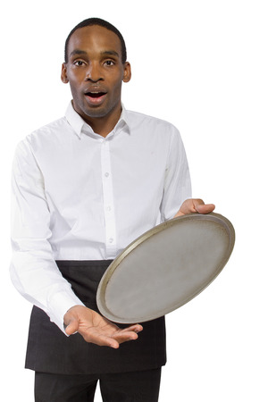 young male waiter dropping a tray and falling forward photo