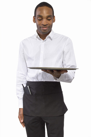 black male waiter carrying a blank tray for composites photo