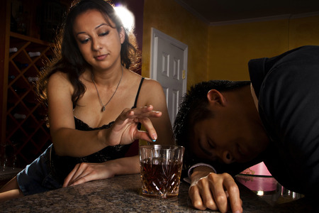 alcoholic drink: putting rohypnol on an alcoholic drink Stock Photo