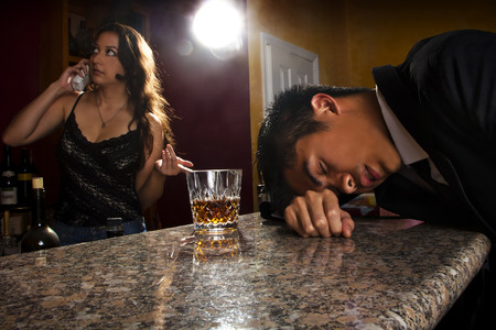 knocked out: bartender calling a cab for drunk customer
