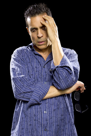 depressed or stressed man in black background photo