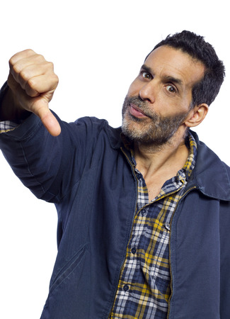 disapprove: blue collar worker dissaproving with a thumbs down gesture Stock Photo