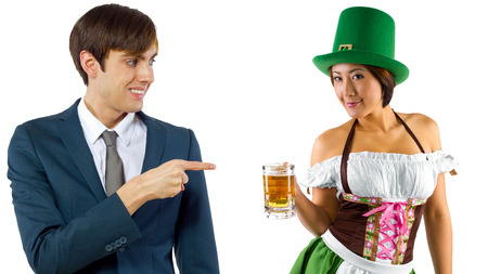 st  patty's: young female dressed in St Pattys costume serving customers