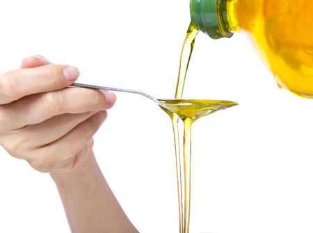 cooking oil: Trending oral health practice of Oil Pulling or Swishing Stock Photo