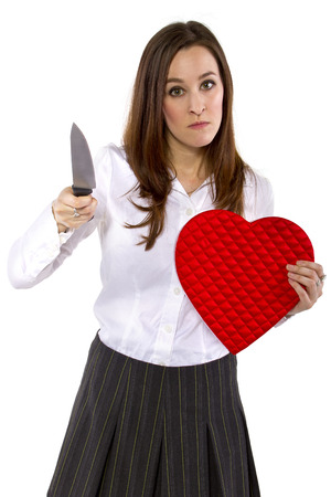 broken hearted ex-girlfriend with a heart and knife photo