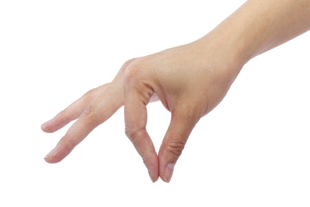 pinching: female hand picking up something invisible for composites Stock Photo