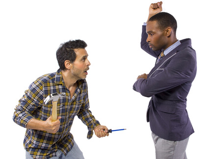 business executive being bossy to a blue collar worker