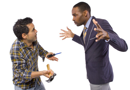 violence in the workplace: business executive being bossy to a blue collar worker