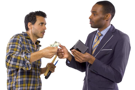 debt collection: businessman paying hired blue collar laborer for services