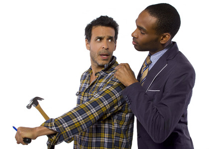 rebelling: Blue collar worker vs white collar professional Stock Photo
