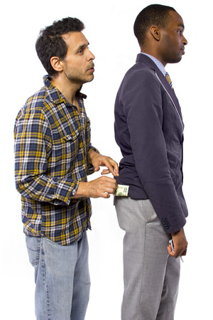 sneaky: sneaky man stealing cash from a victim Stock Photo
