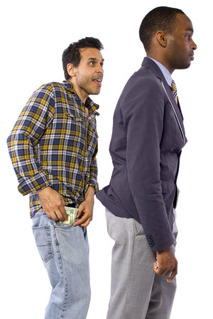 sneaky man stealing cash from a victim Stock Photo - 27145152