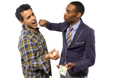 sneaky man stealing cash from a victim Stock Photo