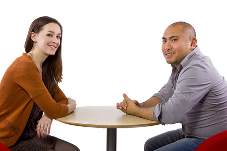 interracial couple on a casual coffeeshop date photo
